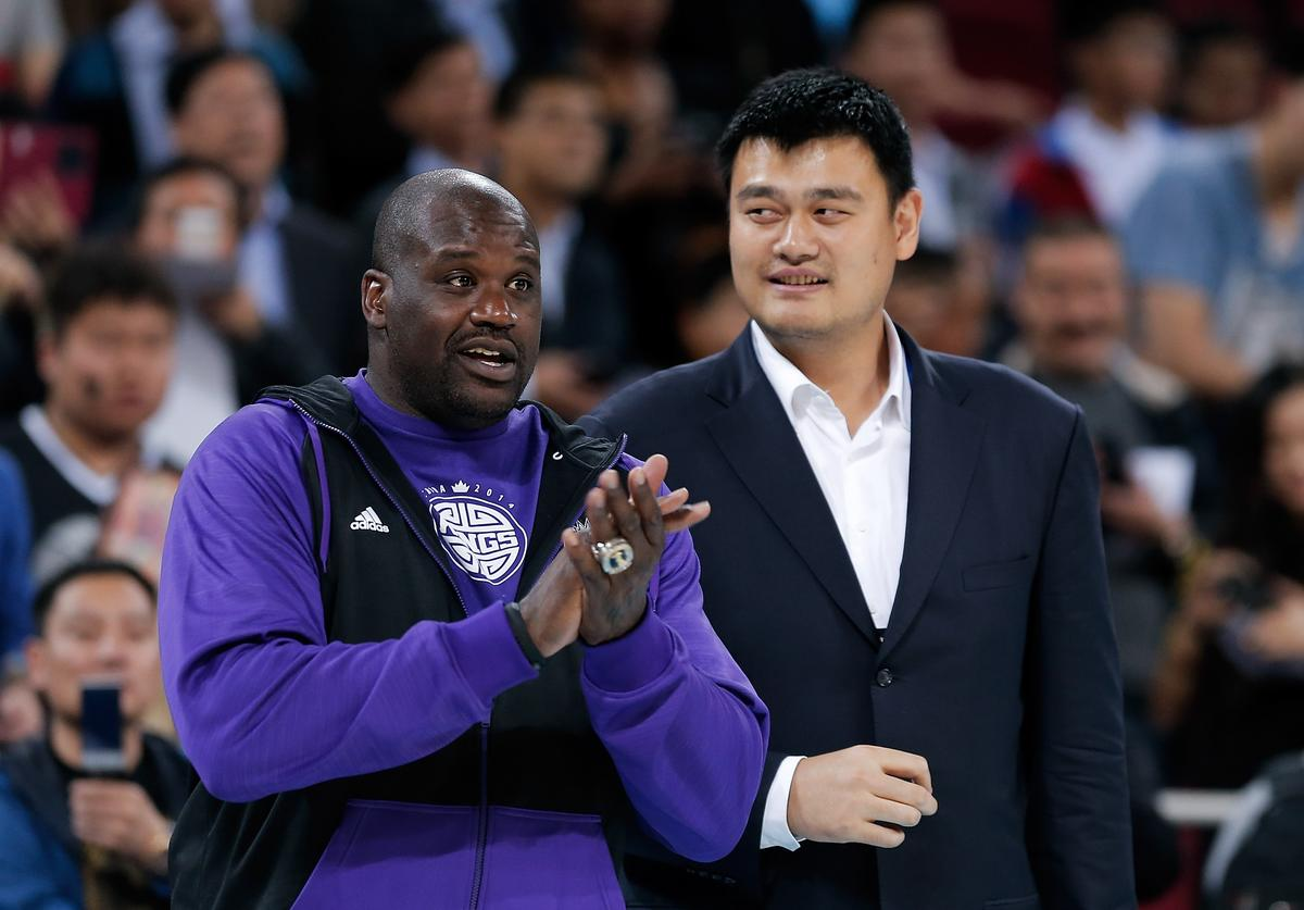 Yao Ming (R) former NBA basketball star talk with Shaquille O'Neal during the 2014 NBA Global Games match between the Brooklyn Nets and Sacramento Kings at MasterCard Center on October 15, 2014 in Beijing, China.