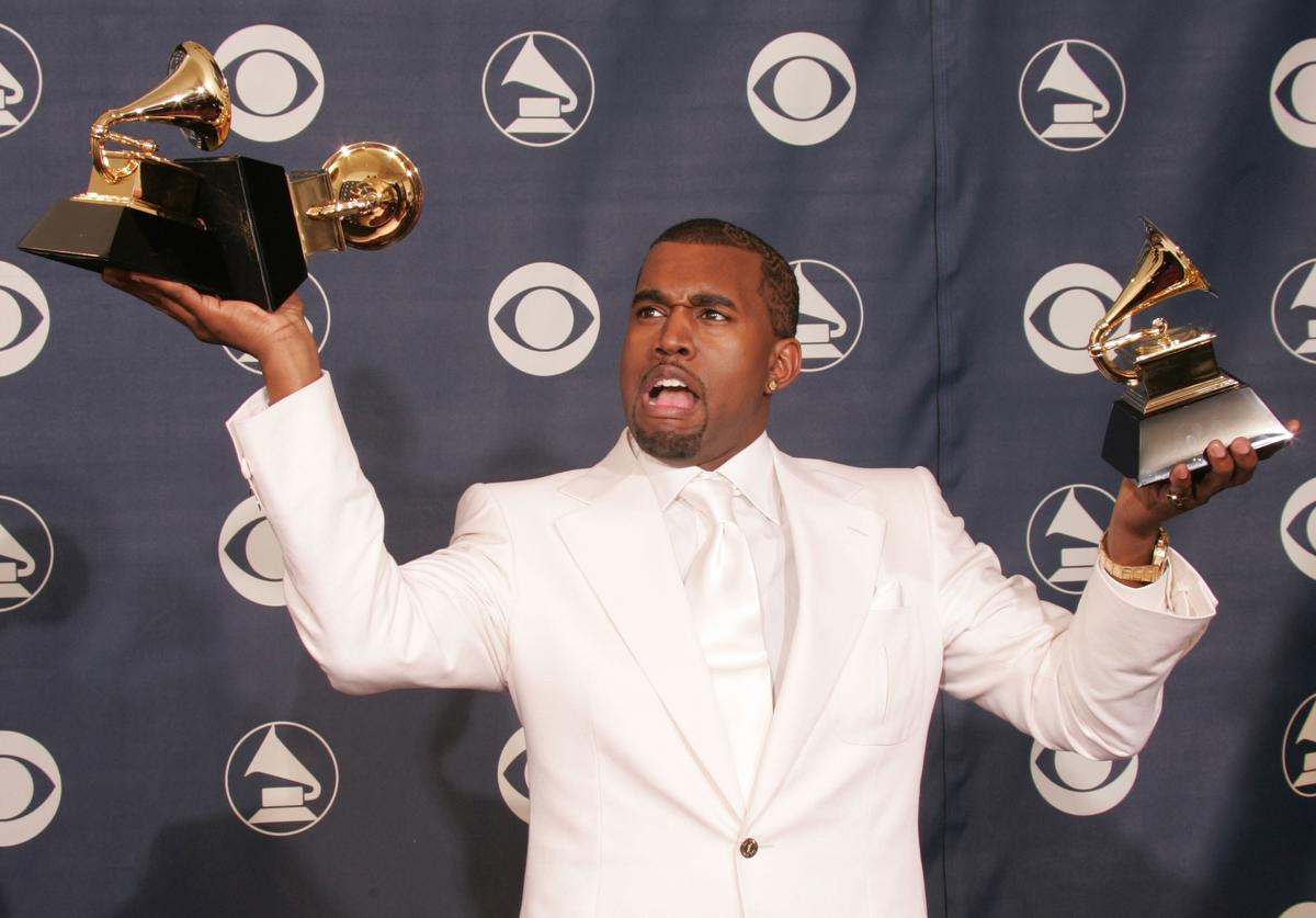 Kanye West poses backstage with his awards for 'Best Rap Album', 'Best Rap Song', and 'Best R & B Song' during the 47th Annual Grammy Awards at the Staples Center February 13, 2005 in Los Angeles, California.