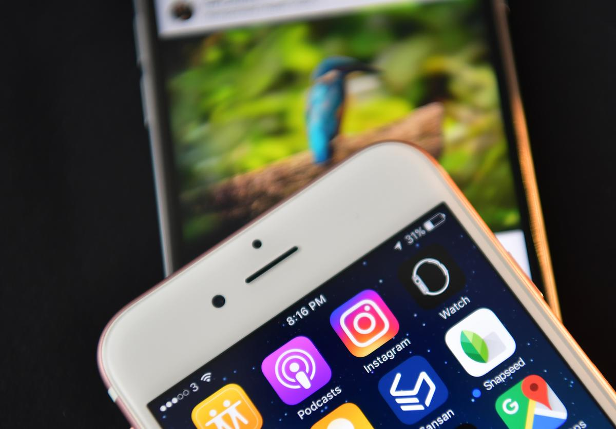 The Instagram app logo is displayed next to an 'Instagrammed' image on another iPhone on August 3, 2016 in London, England.