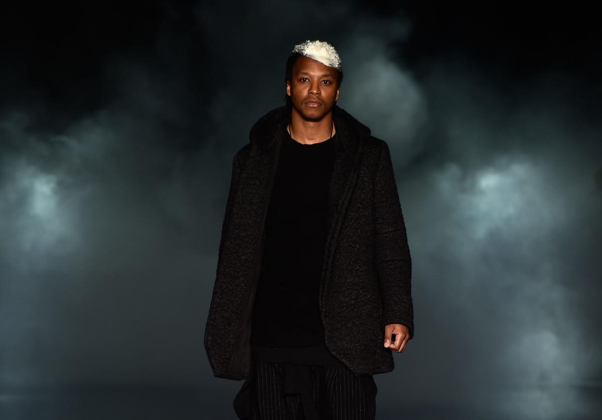 Lupe Fiasco on the runway at the 2014 Mercedes Benz Fashion week.