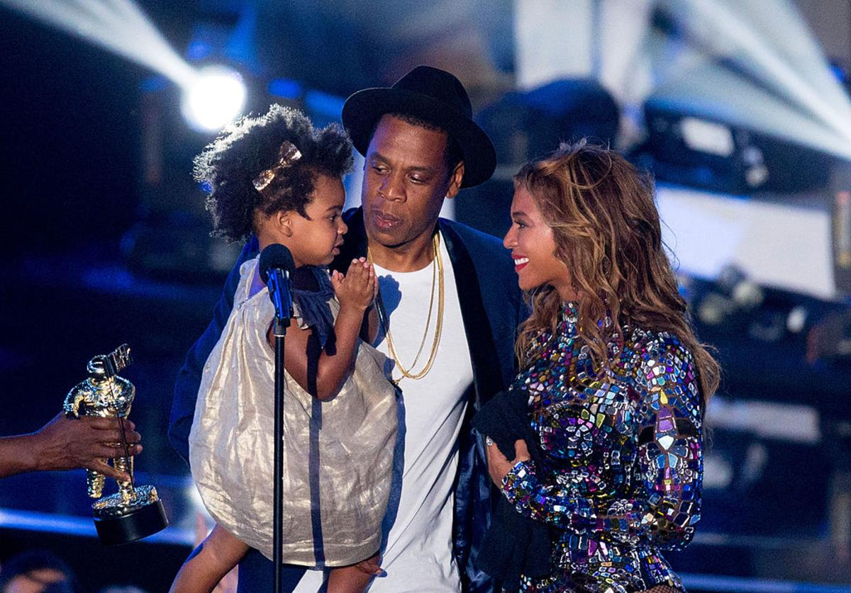 apper Jay Z and singer Beyonce with daughter Blue Ivy Carter onstage during the 2014 MTV Video Music Awards at The Forum on August 24, 2014 in Inglewood, California.