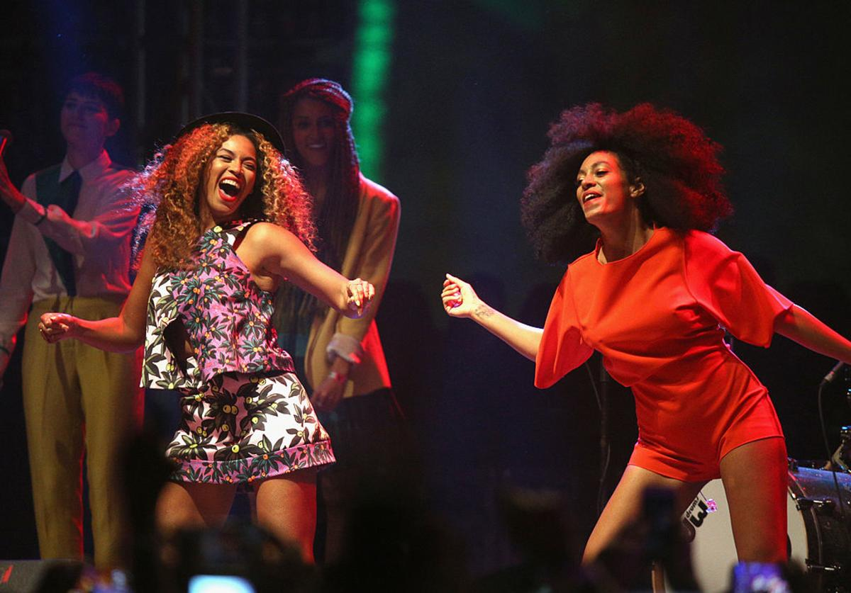 Beyonce (L) and Solange perform onstage during day 2 of the 2014 Coachella Valley Music & Arts Festival at the Empire Polo Club on April 12, 2014 in Indio, California.