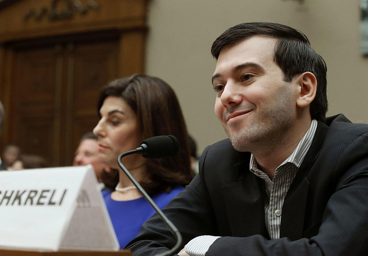 Martin Shkreli, former CEO of Turing Pharmaceuticals LLC., smiles while flanked by Nancy Retzlaff, chief commercial officer for Turing Pharmaceuticals LLC., during a House Oversight and Government Reform Committee hearing on Capitol Hill, February 4, 2016 in Washington, DC.