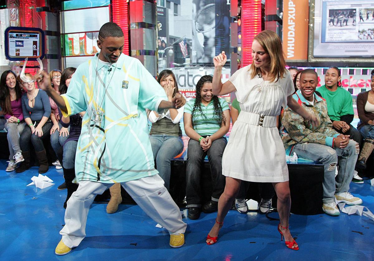 Actress Natalie Portman and recording artist Soulja Boy appear onstage during MTV's Total Request Live at the MTV Times Square Studios on November 12, 2007 in New York City.