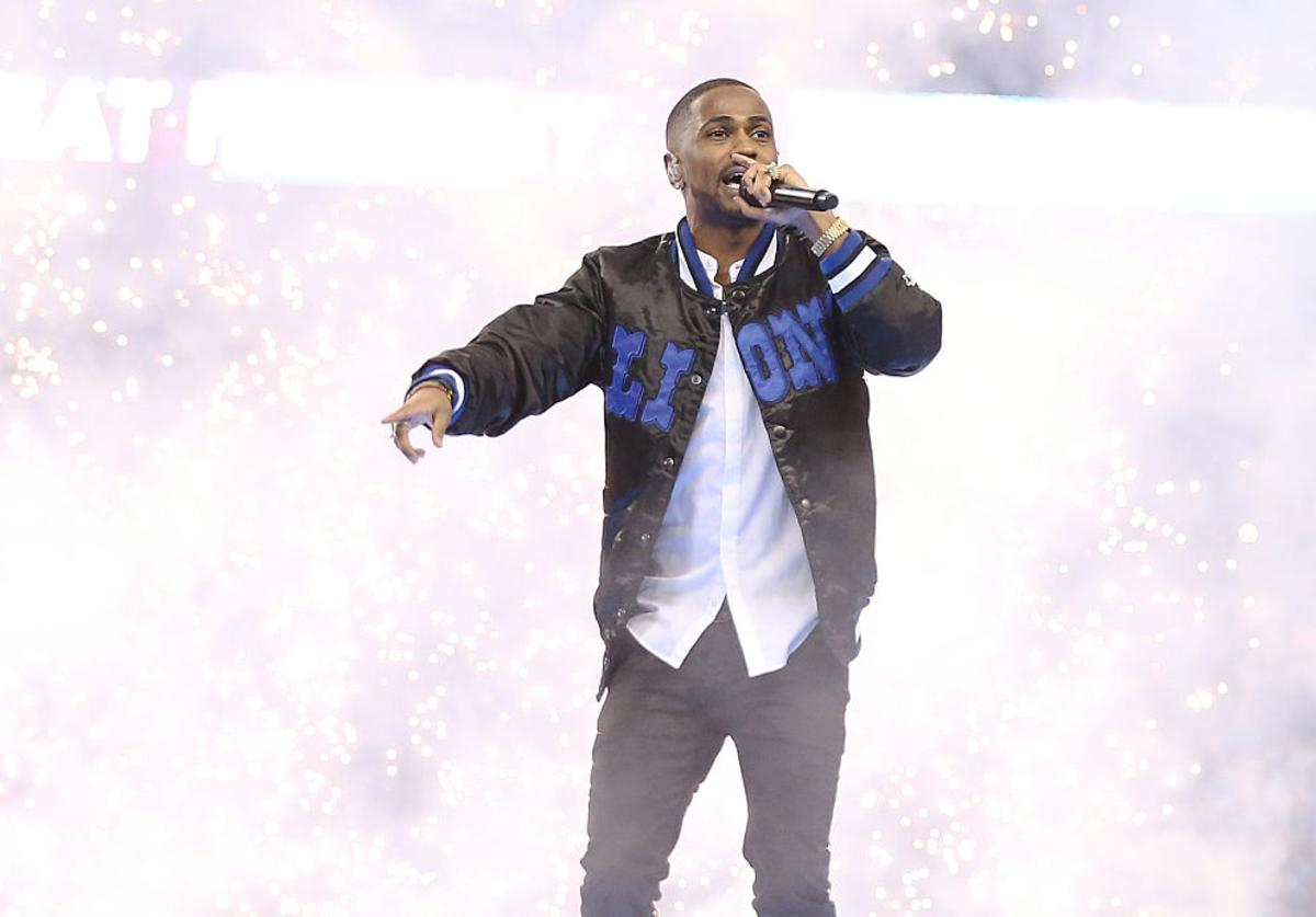 Big Sean performs during the half time show of the Detroit Lions vs. Philadelphia Eagles Thanksgiving Day Game on November 26, 2015 at Ford Field in Detroit, Michigan.
