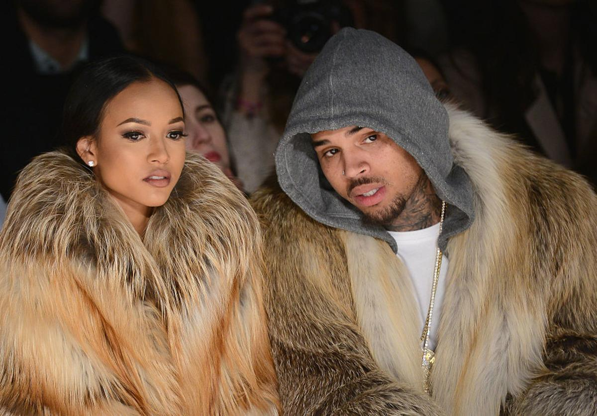Karrueche Tran and Chris Brown attend the Michael Costello fashion show during Mercedes-Benz Fashion Week Fall 2015  at The Salon at Lincoln Center on February 17, 2015 in New York City.