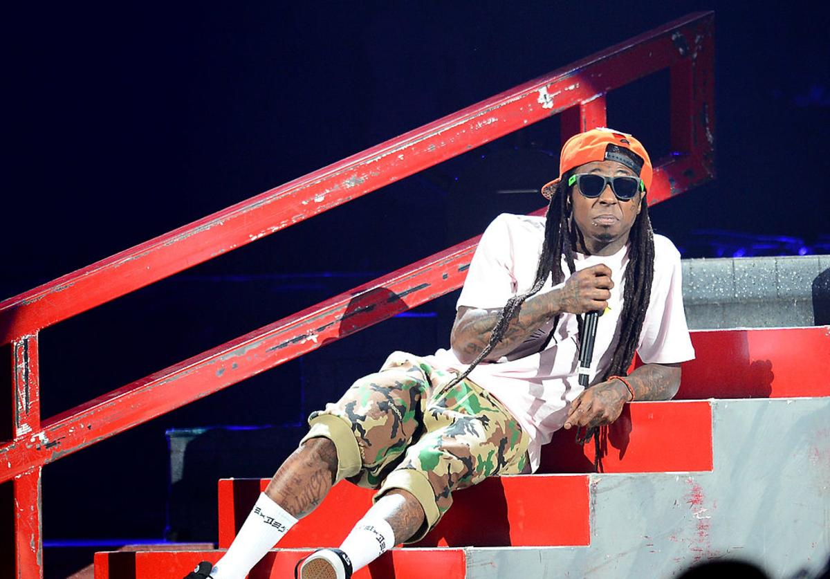 Lil Wayne performs during the America's Most Wanted Music Festival at the MGM Grand Garden Arena on August 31, 2013 in Las Vegas, Nevada.
