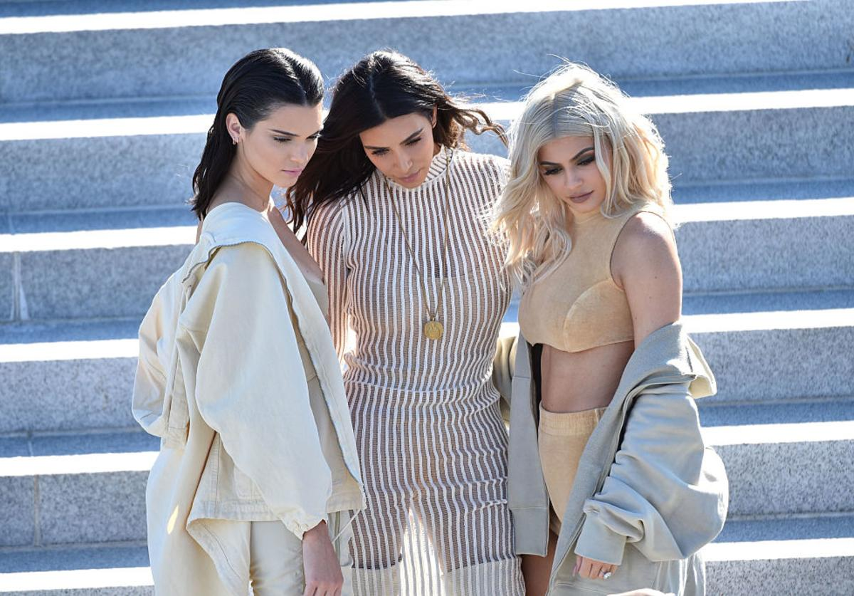 (L-R) Kendall Jenner, Kim Kardashian and Kylie Jenner attend the Kanye West Yeezy Season 4 fashion show on September 7, 2016 in New York City.