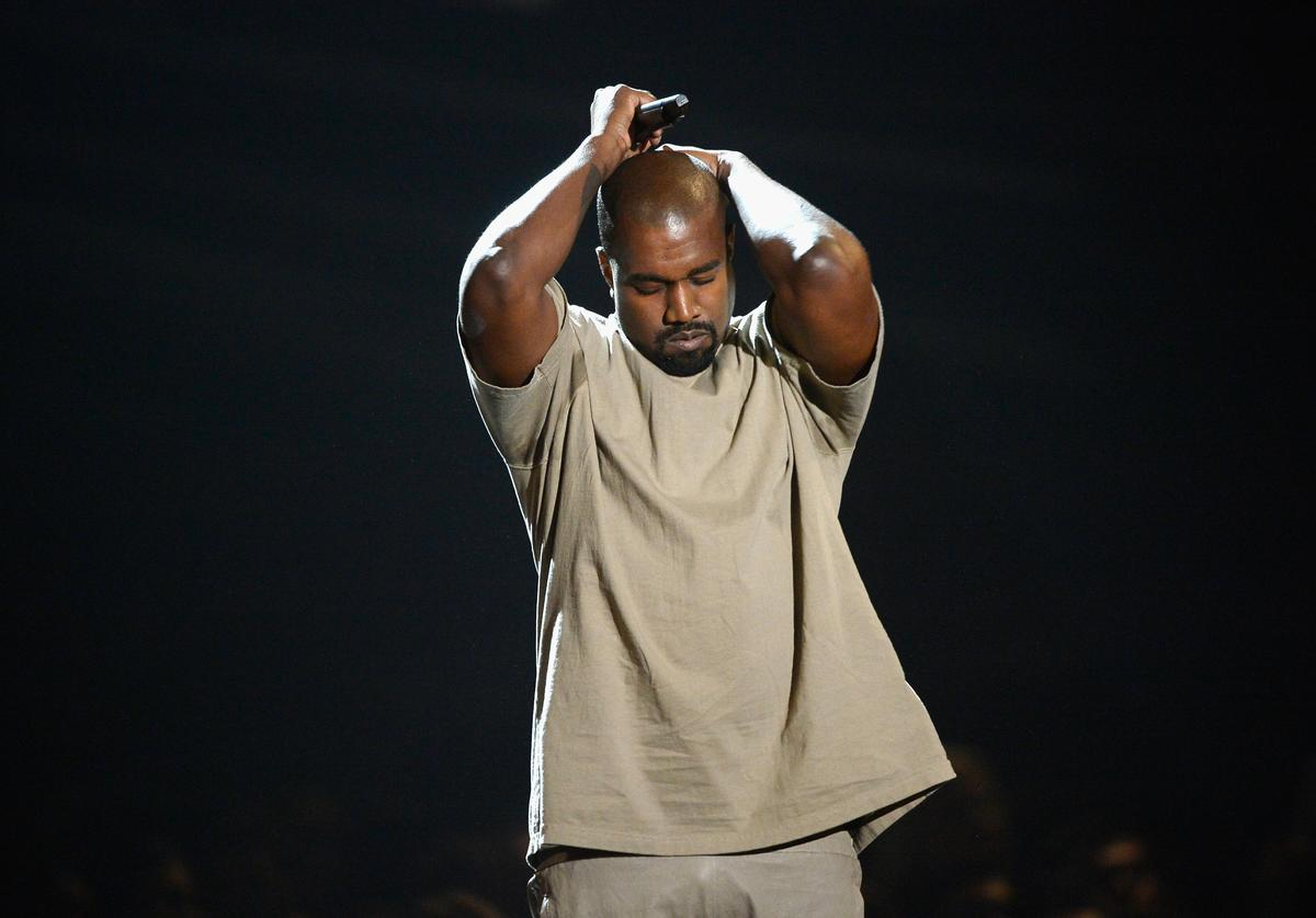 Kanye West speaks onstage during the 2015 MTV Video Music Awards