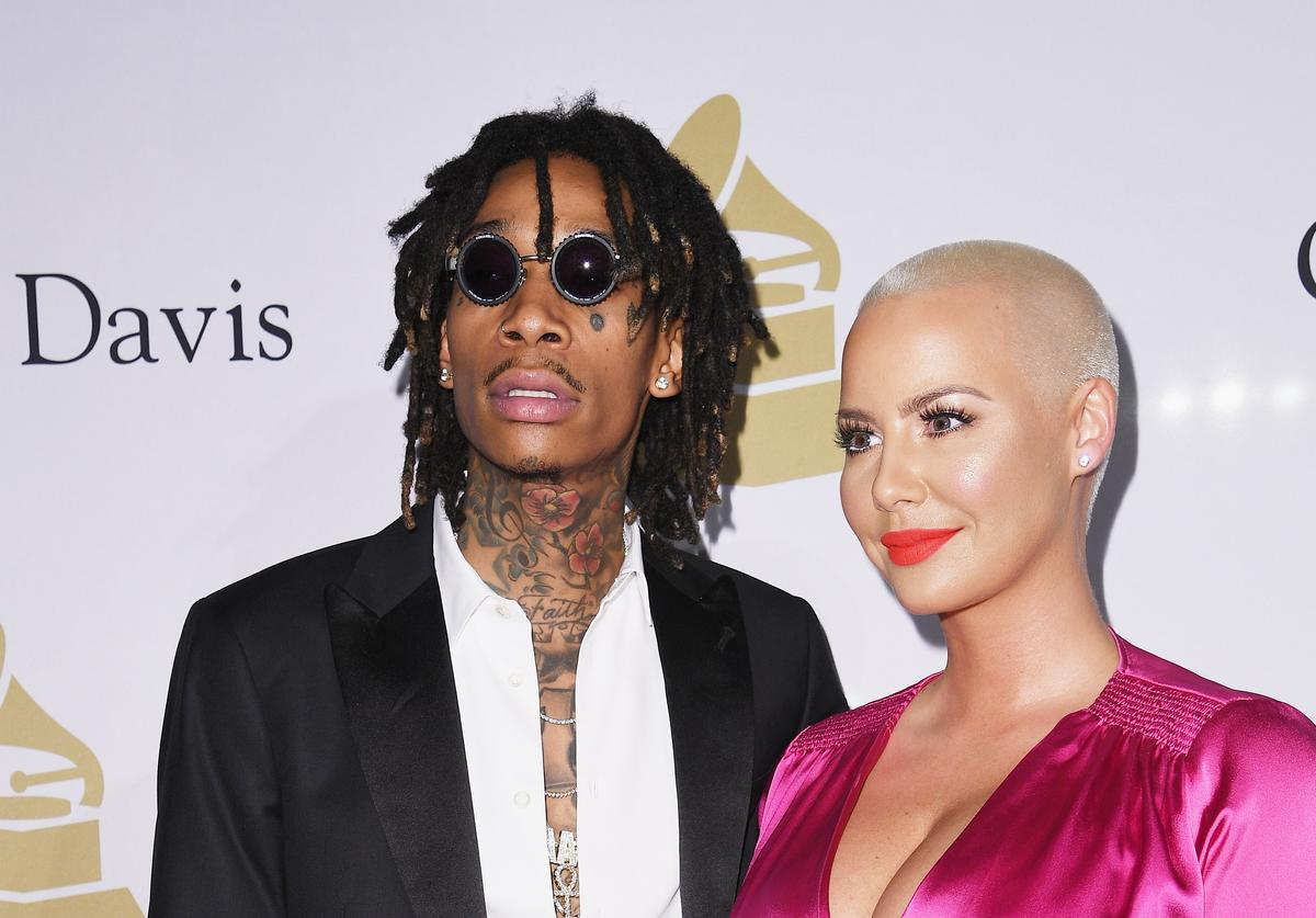 Recording artist Wiz Khalifa (L) and Amber Rose attend Pre-GRAMMY Gala and Salute to Industry Icons Honoring Debra Lee at The Beverly Hilton on February 11, 2017 in Los Angeles, California.