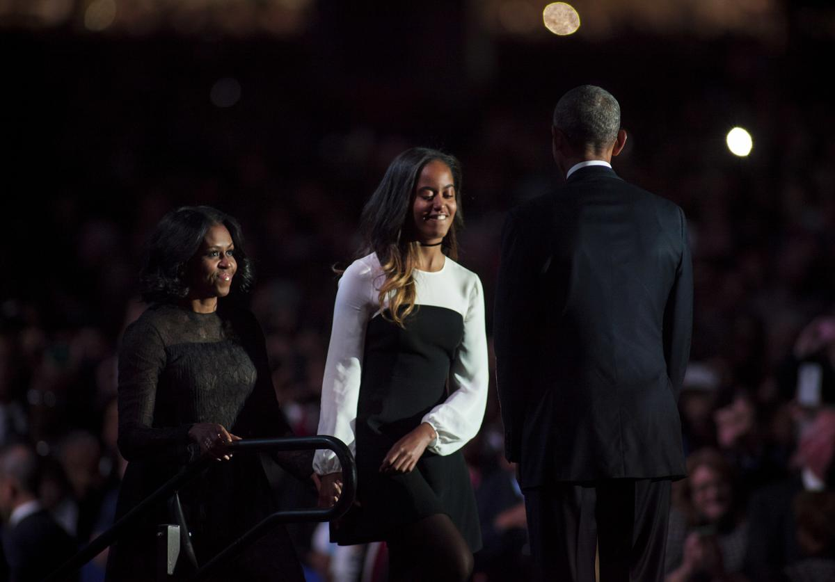 U.S. President Barack Obama greets daughter Malia and first lady Michelle Obama on stage after delivering his farewell address at McCormick Place on January 10, 2017 in Chicago, Illinois. Obama addressed the nation in what is expected to be his last trip outside Washington as president. President-elect Donald Trump will be sworn in as the 45th president on January 20.