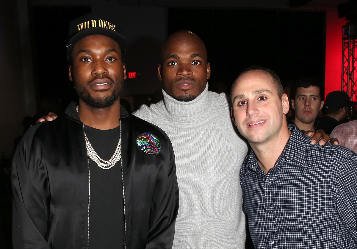 Rapper Meek Mill, NFL player Adrian Peterson, and Fanatics Owner Michael Rubin attend the Fanatics Super Bowl Party at Ballroom at Bayou Place on February 4, 2017 in Houston, Texas.