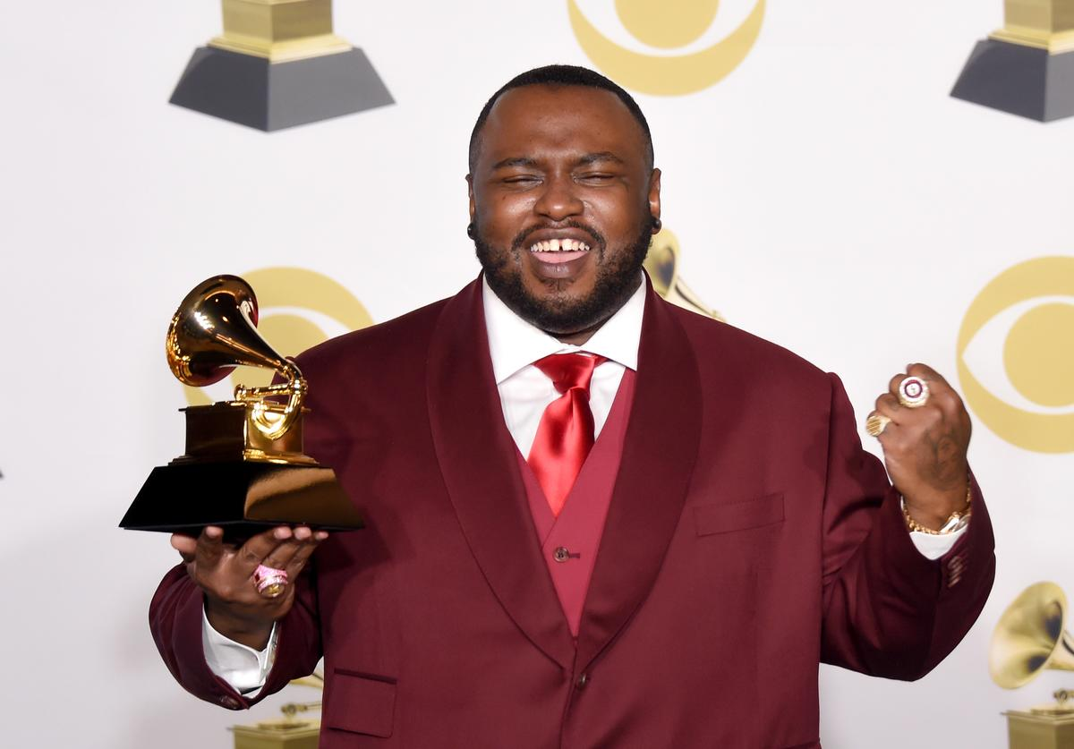 James Fauntleroy, winner of Best R&B Song for 'That's What I Like' pose in the press room during the 60th Annual GRAMMY Awards