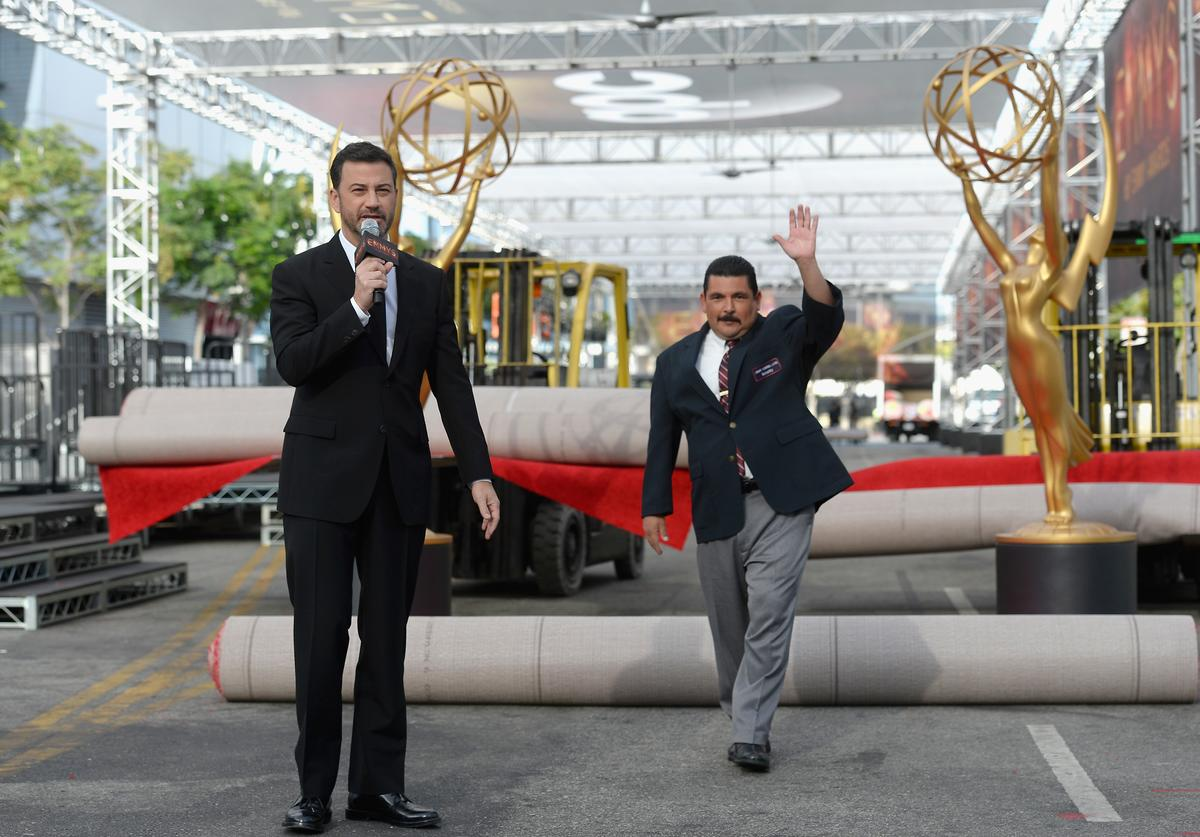 Jimmy Kimmel speaks as television personality Guillermo Rodriguez greets the press during the red carpet rollout for the 68th Emmy Awards