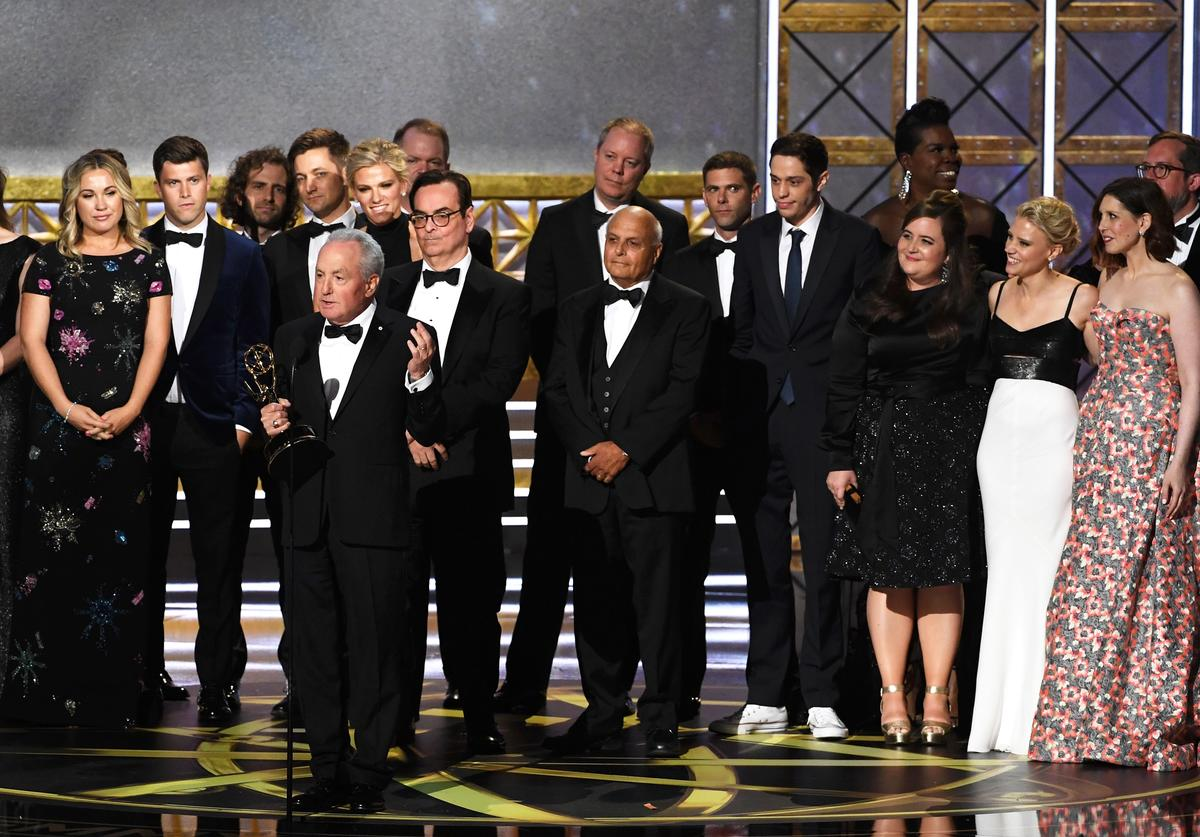 Producer Lorne Michaels (at microphone) and cast/crew accept Outstanding Variety Sketch Series for 'Saturday Night Live' onstage during the 69th Annual Primetime Emmy Awards at Microsoft Theater on September 17, 2017 in Los Angeles, California