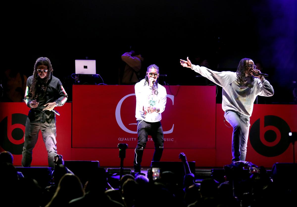 Takeoff, Offset, and Quavo of music group Migos perform onstage during 'All-Star Weekend Kick-Off Party' at Capitol Records Tower on February 15, 2018 in Los Angeles, California