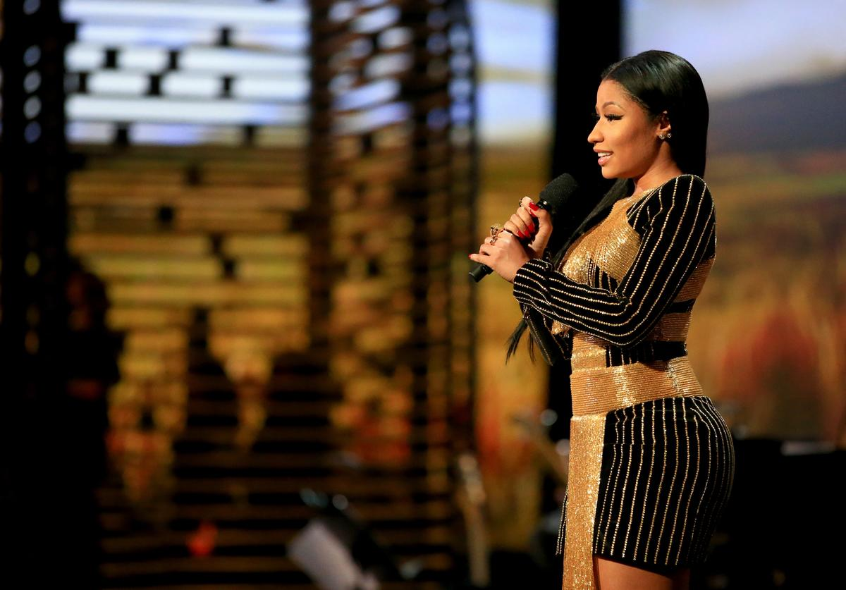 Nicki Minaj speaks onstage at A+E Networks 'Shining A Light' concert at The Shrine Auditorium on November 18, 2015 in Los Angeles, California