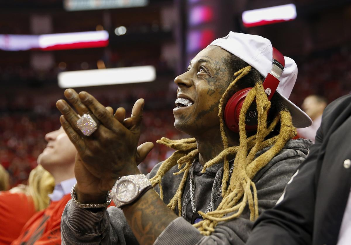 Lil Wayne applauds in the second half during Game One of the Western Conference Semifinals of the 2018 NBA Playoffs between the Houston Rockets and the Utah Jazz at Toyota Center on April 29, 2018 in Houston, Texas