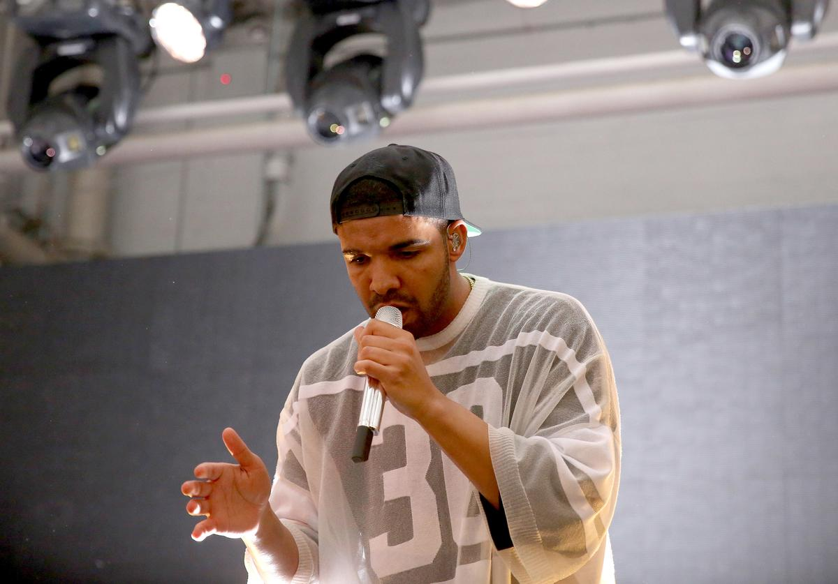 Drake performs at the Time Warner Cable Studios and Revolt Bring the Music Revolution event on February 1, 2014 in New York City