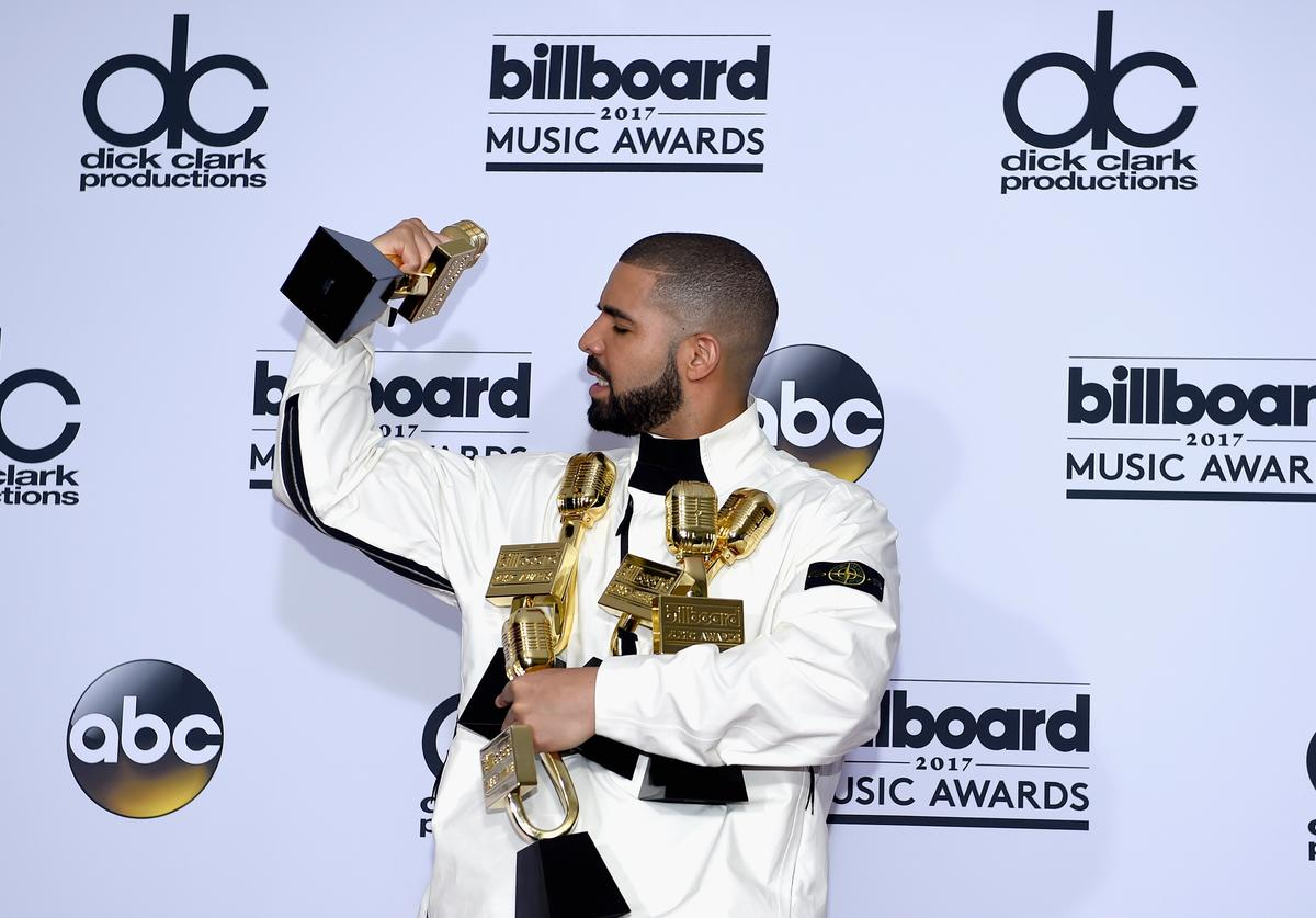 Drake poses in the press room with his awards for Top Artist, Top Male Artist, Top Billboard 200 Artist, Top Billboard 200 Album for 'Views,' Top Hot 100 Artist, Top Song Sales Artist, Top Streaming Artist, Top Streaming Song (Audio) for 'One Dance,' Top R&B Song for 'One Dance,' Top R&B Collaboration for 'One Dance,' Top Rap Artist, Top Rap Album for 'Views,' and Top Rap Tour during the 2017 Billboard Music Awards at T-Mobile Arena on May 21, 2017 in Las Vegas, Nevada