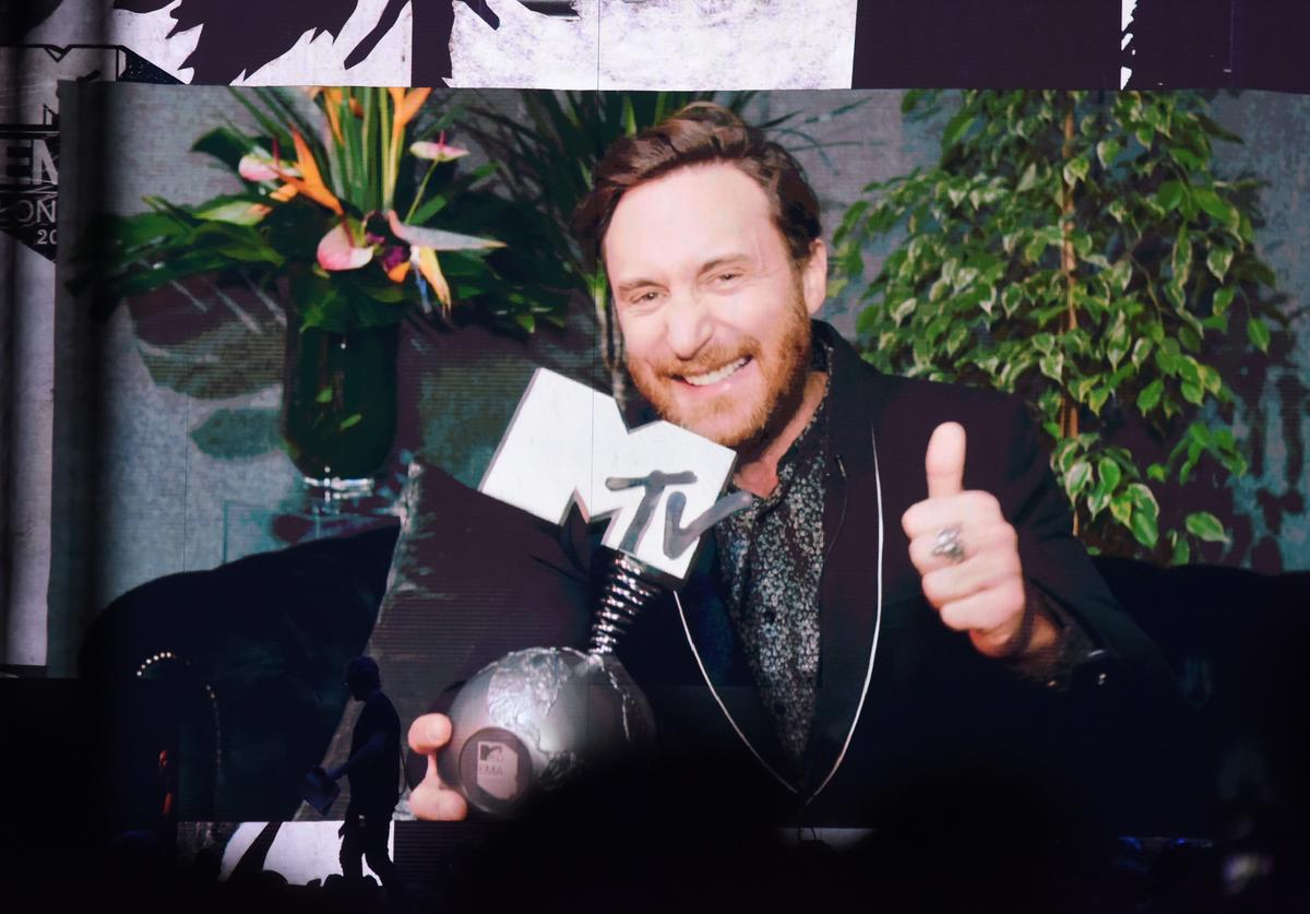 David Guetta is seen on screen accepting an award during the MTV EMAs 2017 held at The SSE Arena, Wembley on November 12, 2017 in London, England