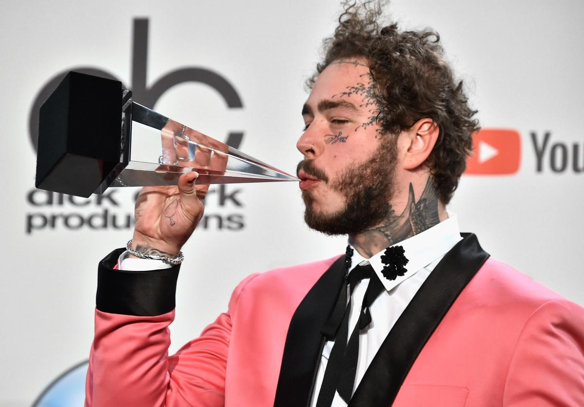 Post Malone, winner of the Favorite Male Artist - Pop/Rock award, poses in the press room during the 2018 American Music Awards at Microsoft Theater on October 9, 2018 in Los Angeles, California