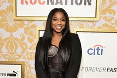 Reginae Carter Claps Back At Fan Who Says She Needs Breast Implants
