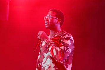 Gucci Mane Pushes Fan Away After She Jumps On Stage