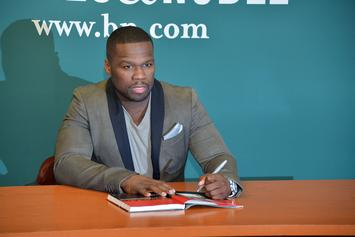 50 Cent Steps Out At Barclays Center With Fitness Model