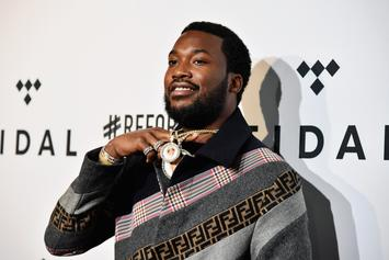 Meek Mill Gets Cuddly With A Mystery Lady