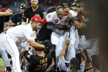 Reds Pitcher Amir Garrett Tries To Fight All Of The Pirates Dugout: Watch