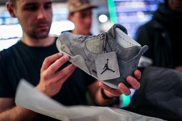 Air Jordan 4 x KAWS Sample Surfaces In Familiar Colorway: Photos