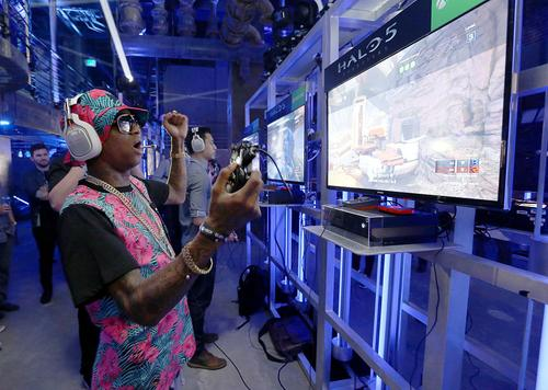 Soulja Boy plays Halo 5 during the Xbox One E3 Showcase Party at The Majestic Downtown on June 15, 2015 in Los Angeles, California.