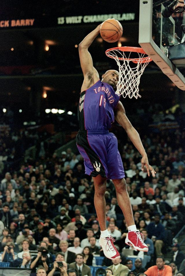 Vince Carter #15 of the Toronto Raptors jumps to make the slam dunk during the NBA Allstar Game Slam Dunk Contest at the Oakland Coliseum in Oakland, California.