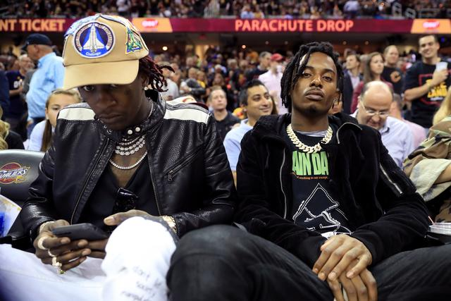 Playboi Carti with Young Thug at a basketball game