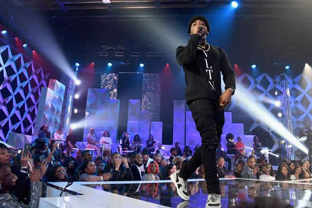 YFN Lucci performing on stage
